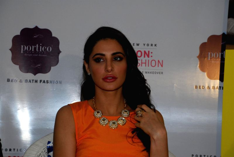 Actress Nargis Fakhri during the launch of Mission Home Fashion by Portico New York in Mumbai on Aug 4, 2014. - Nargis Fakhri