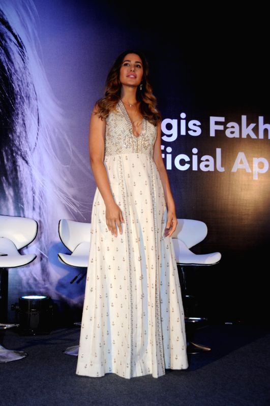Actress Nargis Fakhri during the launch of her own mobile app with New York based startup EscapeX in Mumbai on April 11, 2017. - Nargis Fakhri