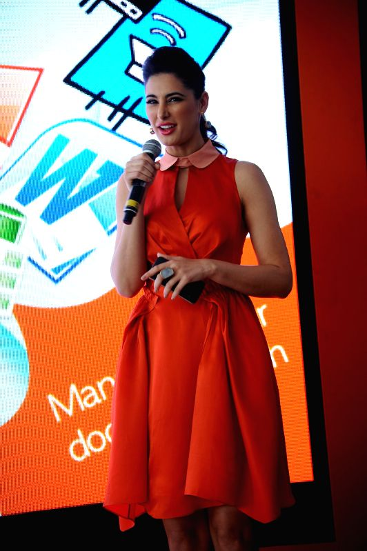 Actress Nargis Fakri at the launch of a social networking application in New Delhi on April 16, 2014.