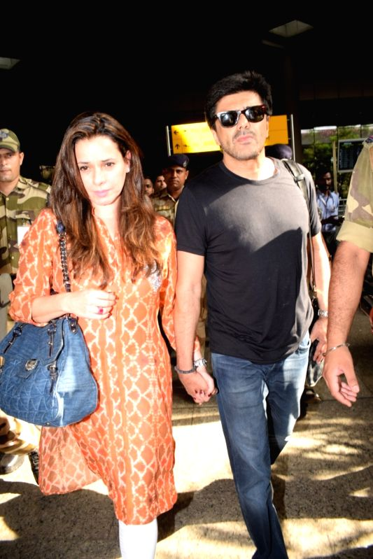 Actress Neelam Kothari with her husband Sameer Soni, returned to Mumbai after being acquitted by a Jodhpur court in the blackbuck poaching case in Mumbai on April 5, 2018. - Neelam Kothari