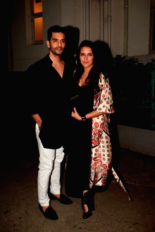 """Actress Neha Dhupia along with her husband Angad Bedi at the pre-release party of upcoming film """"Karwaan"""" in Mumbai on July 26, 2018. - Neha Dhupia and Angad Bedi"""