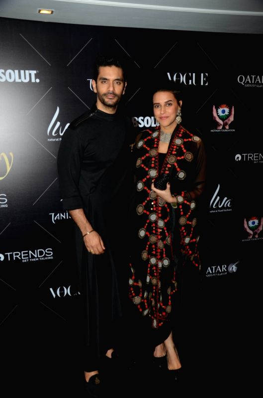 "Actress Neha Dhupia along with her husband Angad Bedi at the red carpet of ""Vogue Beauty Awards"" in Mumbai on July 31, 2018. - Neha Dhupia and Angad Bedi"