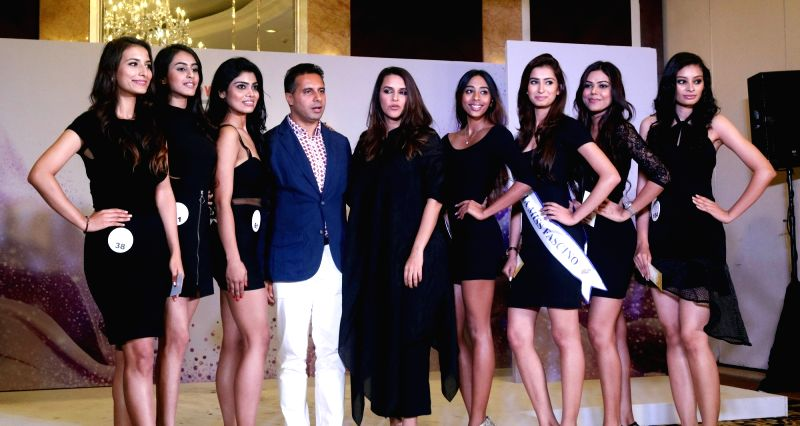 Actress Neha Dhupia and fashion designer Shantanu with the selected models for the audition of Miss Universe 2016, 'Miss DIVA', in New Delhi on July 17, 2016. - Neha Dhupia