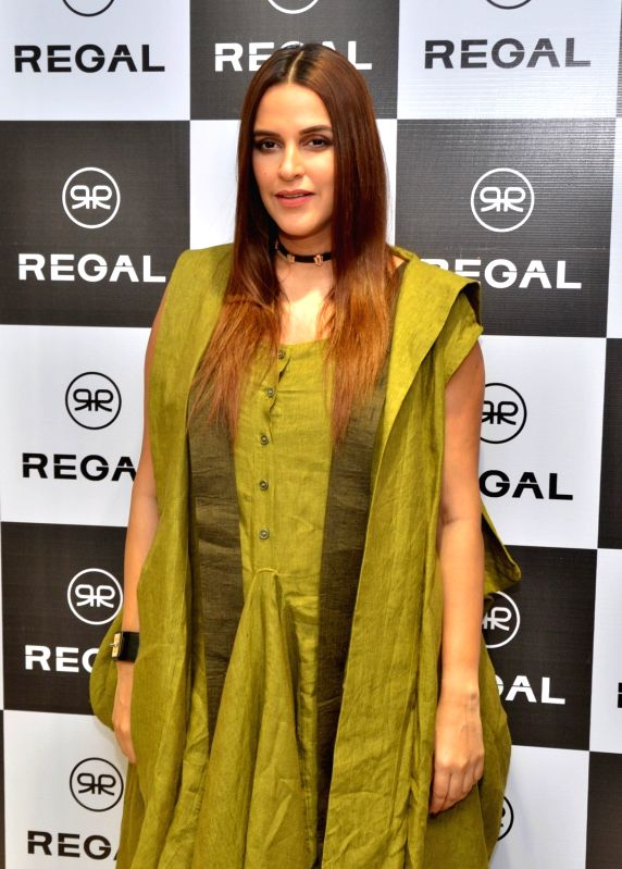 Actress Neha Dhupia at the launch of a shoe store, in Guwahati on July 5, 2018.