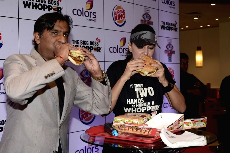 Actress Neha Dhupia during the launch of the Big Boss Whopper in association with Big Boss Season 9, in New Delhi on Nov 17, 2015.