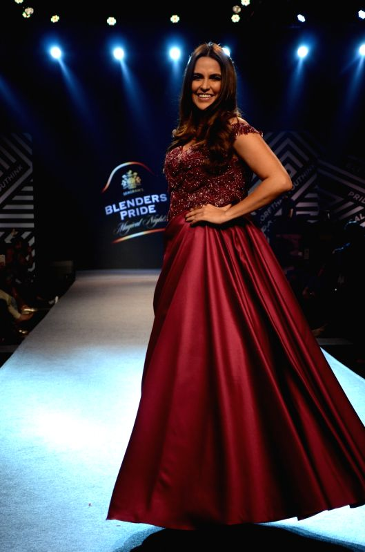 Actress Neha Dhupia showcases creations of fashion designer Sonaakshi Raaj at Blenders Pride Magical Nights in Mumbai on April 13, 2018. - Neha Dhupia