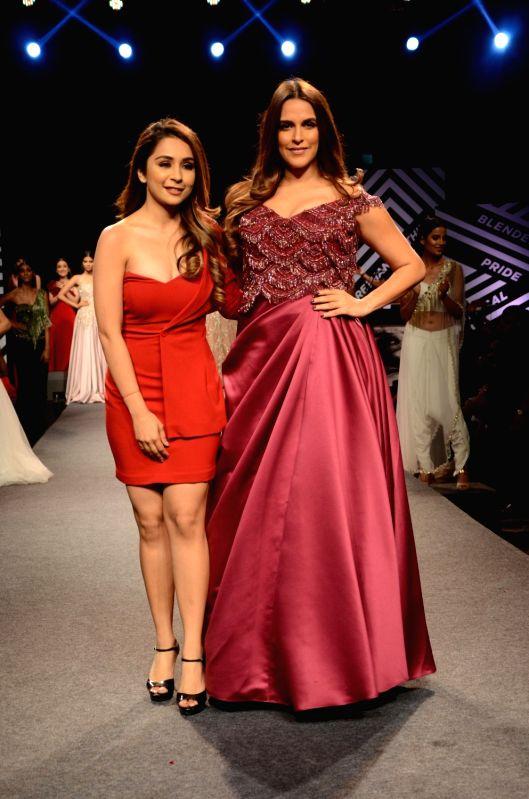 Actress Neha Dhupia showcases creations of fashion designer Sonaakshi Raaj at Blenders Pride Magical Nights in Mumbai on April 13, 2018. - Neha Dhupia