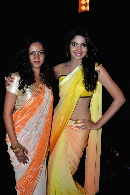 Actress Neha Joshi and Pooja Sawant during the promotional song shoot of upcoming Marathi film Poshter Boyz  in Mumbai on May 6, 2014. - Neha Joshi