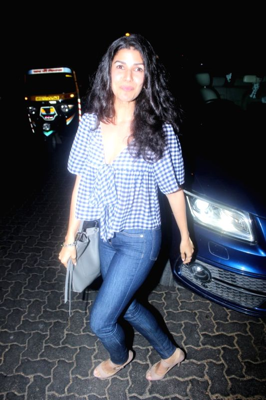 Actress Nimrat Kaur spotted at airport in Mumbai on May 24, 2017. - Nimrat Kaur