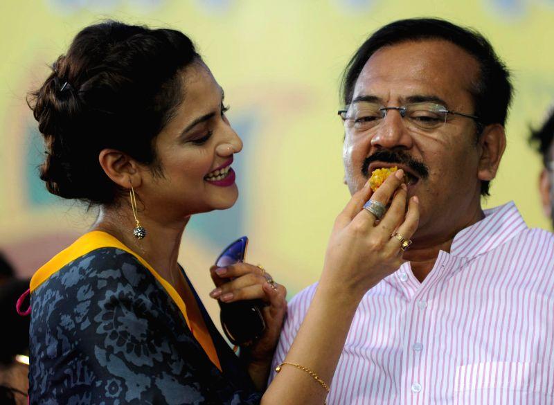Actress Noor Jahan and West Bengal Housing and Youth Affairs Minister Aroop Biswas during `Raksha Bandhan Utsab` in Kolkata on Aug 10, 2014. - Noor Jahan