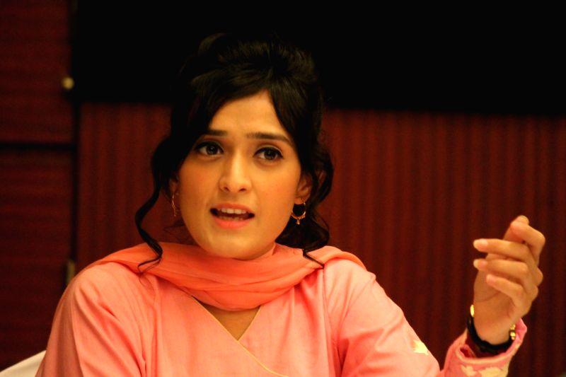 """Actress Pankhuri Awasthi addresses a press conference to promote her TV serial """"Kya Qusoor Hai Amla Ka?"""" in Nagpur on April 22, 2017. - Pankhuri Awasthi"""