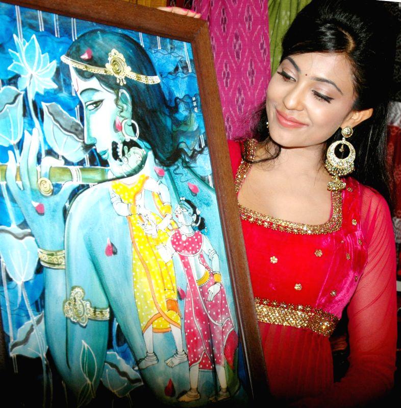 Actress Parvathy Nair during inauguration of `Kala Sammelana` - a handicraft and handloom exhibition organised by Abhiman Craft Society at Chitrakala Parishath in Bangalore on June 27, 2014. - Parvathy Nair