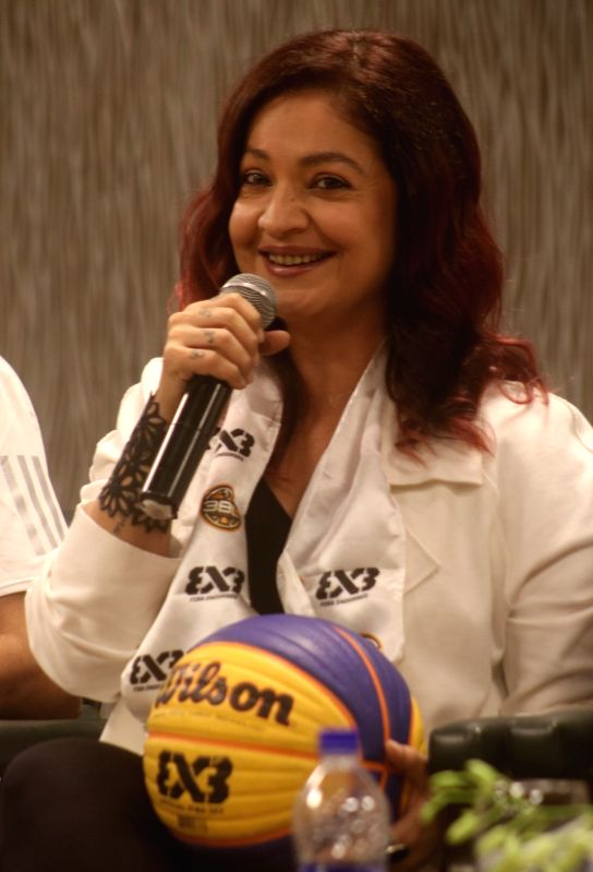 Actress Pooja Bhatt addresses at 'Delhi Hoopers' press conference regarding International Basketball Federation (FIBA) 3BL—3 x 3 Pro Basketball League, in New Delhi on June 9, 2018. - Pooja Bhatt
