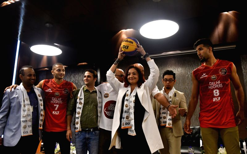 Actress Pooja Bhatt with the players and officials of 'Delhi Hoopers' at the team press conference regarding International Basketball Federation (FIBA) 3BL—3 x 3 Pro Basketball League, ... - Pooja Bhatt