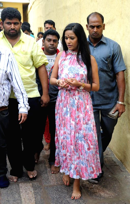 Actress Poonam Pandey at Chamundeshwari Hills for promotion of her upcoming film 'Love is Poison' in Mysore on June 18, 2014. - Poonam Pandey