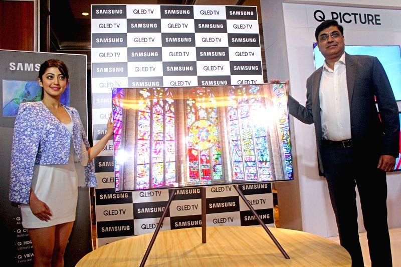 Actress Pranitha Subhash and Samsung India Vice President (Consumer Electronics Business) Rajeev Bhutani at the launch of Samsung QLED TV in Bengaluru on May 24, 2017. - Pranitha Subhash