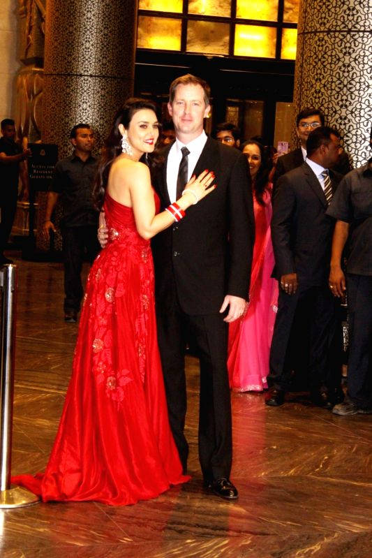 Actress  Preity Zinta and her husband Gene Goodenough during their wedding reception in Mumbai, on May 13, 2016. - Preity Zinta