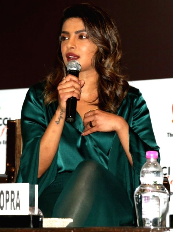 Actress Priyanka Chopra addresses during a FICCI FLO programme in New Delhi on Aug 6, 2018. - Priyanka Chopra
