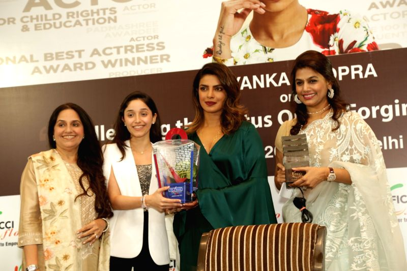 Actress Priyanka Chopra addresses during a FICCI FLO programme in New Delhi on Aug 6, 2018. - Priyanka Chopra