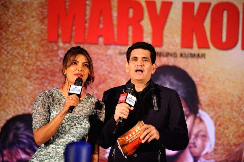 Actress Priyanka Chopra and filmmaker Omung Kumar during the music launch of film Mary Kom in Mumbai on August 13, 2014. - Priyanka Chopra, Mary Kom and Omung Kumar