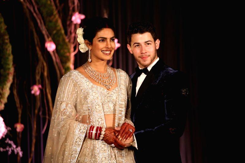 Actress Priyanka Chopra and her husband American singer Nick Jonas at their wedding reception in New Delhi (Image Source: Amlan Paliwal/IANS)