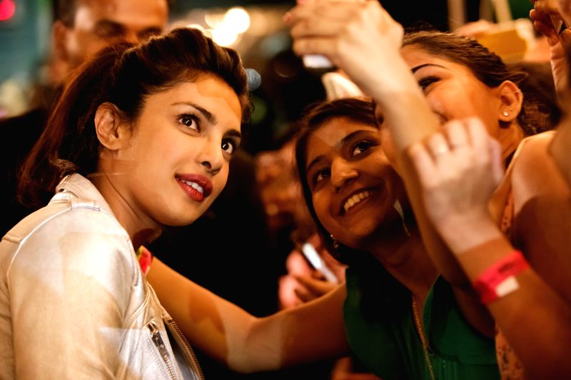 Actress Priyanka Chopra interacts with fans as she arrives to attend the 15th Annual IIFA weekend in Florida of United States of America. - Priyanka Chopra