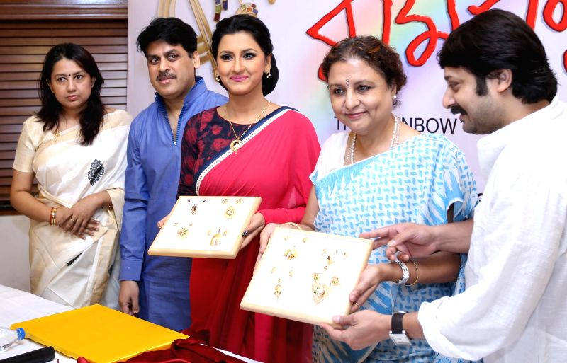 Actress Rachana Banerjee with filmmakers Shibprasad Mukhopadhyay and Nandita Roy during launch of specially designed gold jewellery collections in Kolkata on May 17, 2014. - Nandita Roy