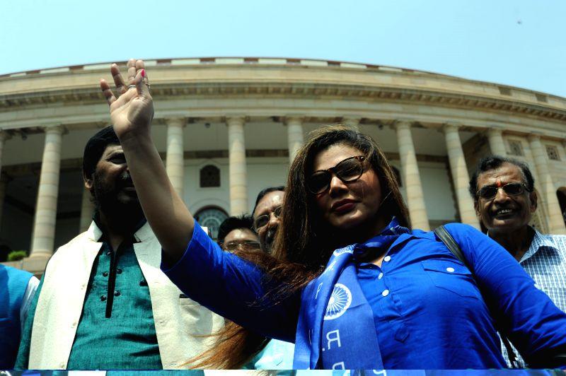 Actress Rakhi Sawant at the Parliament in New Delhi on Aug 12, 2014. - Rakhi Sawant