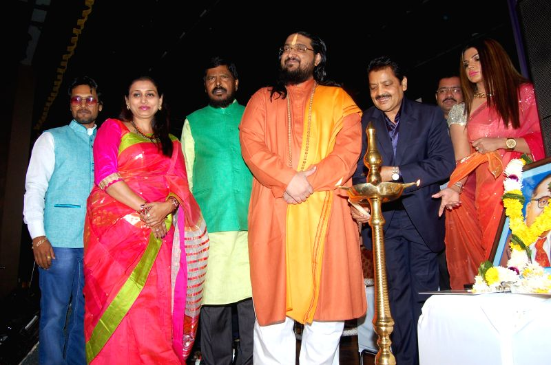 Actress Rakhi Sawant, singer Udit Narayan and RPI leader ramdas athawale during Mahurat of film Godfather of India at ISKCON Temple in Mumbai, on Dec 5, 2014. - Rakhi Sawant