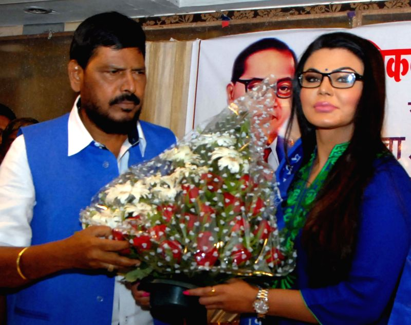 Actress Rakhi Sawant with RPI party chief Ramdas Athavale and other party leaders after joining RPI in Mumbai on June 28, 2014.