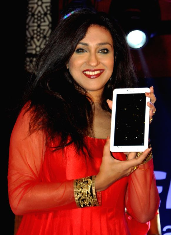 Actress Rituparna Sengupta with CEO of MediaCom, Harbinder Singh Dhaliwal during a mobile launch in Kolkata on Nov 20, 2015. - Harbinder Singh Dhaliwal