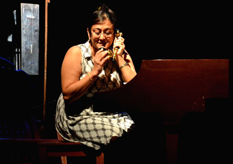 Actress Roshni Aachareja acts in a play - `Piano` which was staged during ongoing Natasurya Drama Festival in Guwahati on Aug 7, 2014. - Roshni Aachareja