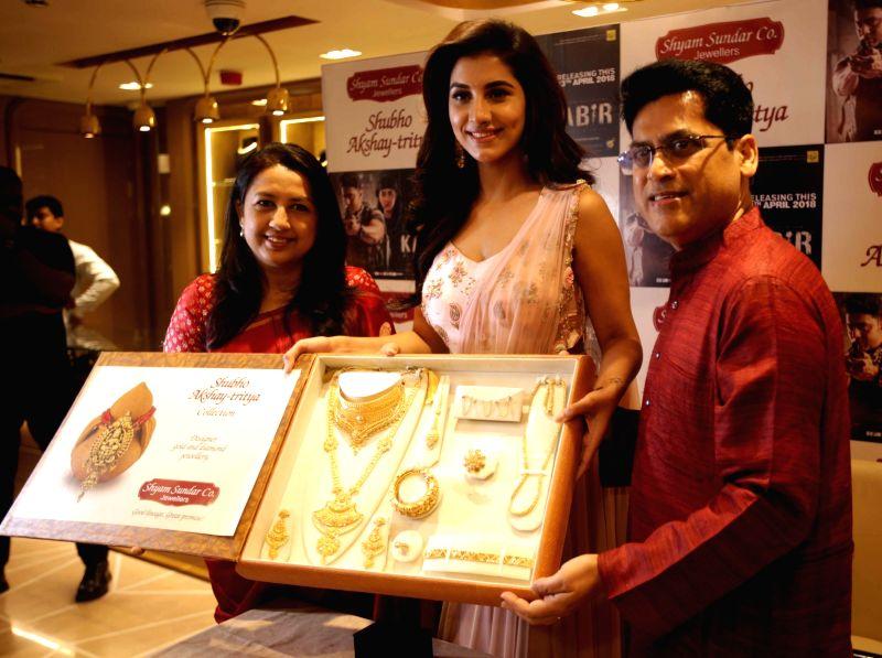 Actress Rukmini Maitra along with Shyam Sunder Co. Jewellary owners Rupak Saha and Arpita Saha during the launch of Akshaya Tritiya Jewellery Collection in Kolkata on April 12, 2018. - Rukmini Maitra