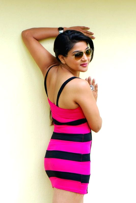 Actress Sakshi poses during a photo shoot.