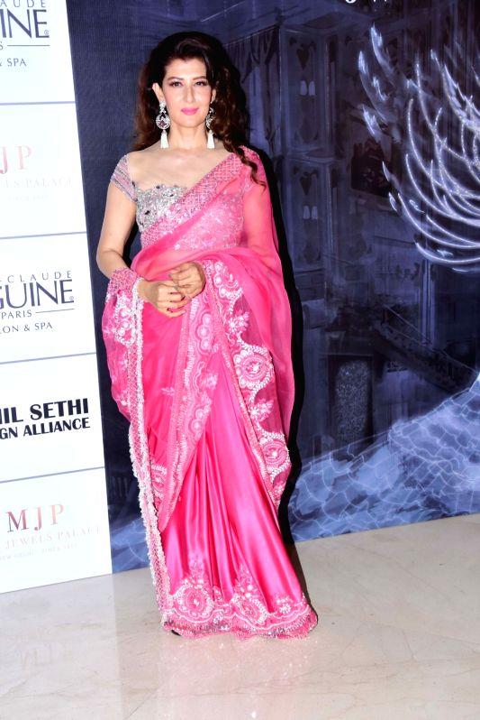 Actress Sangeeta Bijlani at the fashion designer Manish Malhotra's Haute Couture 2018 in Mumbai. - Sangeeta Bijlani and Manish Malhotra