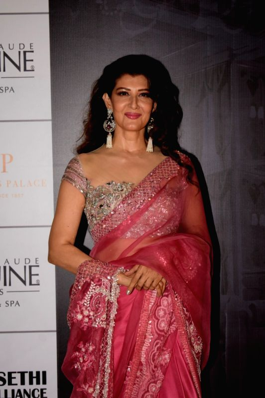 Actress Sangeeta Bijlani at the red carpet of fashion designer Manish Malhotra's haute couture show, in Mumbai on Aug 1, 2018. - Sangeeta Bijlani and Manish Malhotra