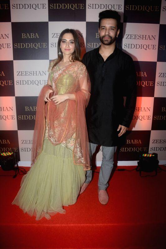 Actress Sanjeeda Shaikh along with her husband Aamir Ali at politician Baba Siddique's iftar party in Mumbai on June 10, 2018. - Sanjeeda Shaikh