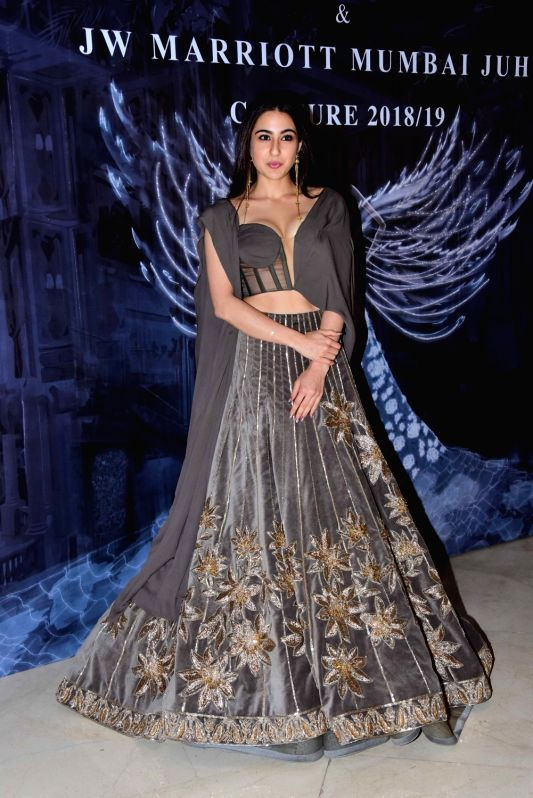Actress Sara Ali Khan at the fashion designer Manish Malhotra's Haute Couture 2018 in Mumbai. - Sara Ali Khan and Manish Malhotra