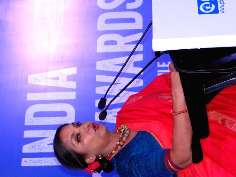 Actress Shabana Azmi addresses during Plan India Impact Awards 2018, in New Delhi on July 27, 2018. - Shabana Azmi
