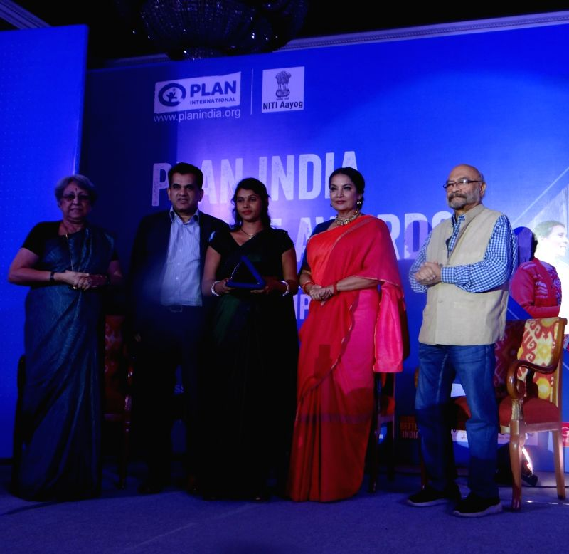 Actress Shabana Azmi presents Plan India Impact Award to Auxiliary Nurse-Midwife (ANM), accredited social health activist and Anganwadi worker Anupam Singh along with NITI Aayog CEO ... - Shabana Azmi and Anupam Singh
