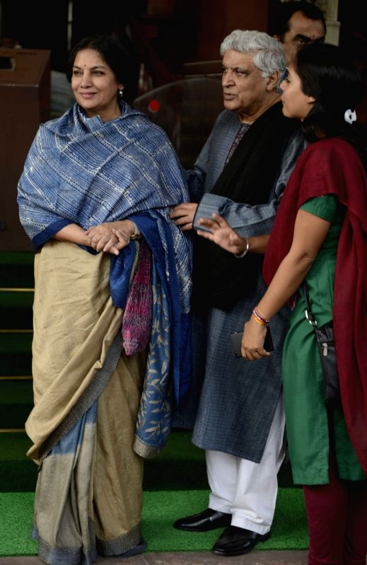 Actress Shabana Azmi with her husband and poet, lyricist and scriptwriter Javed Akhtar at the Parliament House in New Delhi, on Dec 8, 2015. - Shabana Azmi