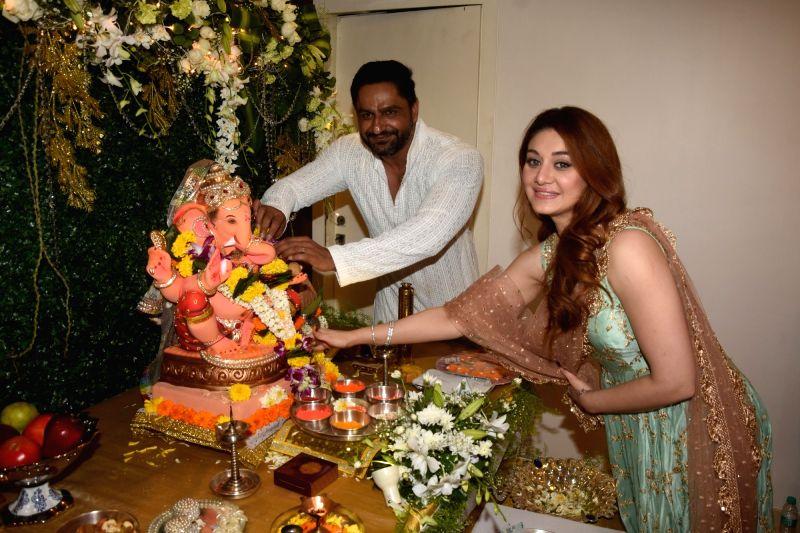 Actress Shefali Zariwala along with her husband Parag Tyagi offer prayers to Lord Ganesha on the occasion of Ganesh Chaturthi, in Mumbai on Sept 13, 2018. - Shefali Zariwala