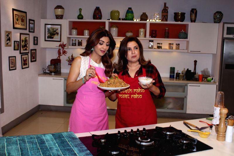 Actress Shilpa Shetty and director Farah Khan during a programme in Mumbai on June 10, 2017. - Shilpa Shetty and Farah Khan