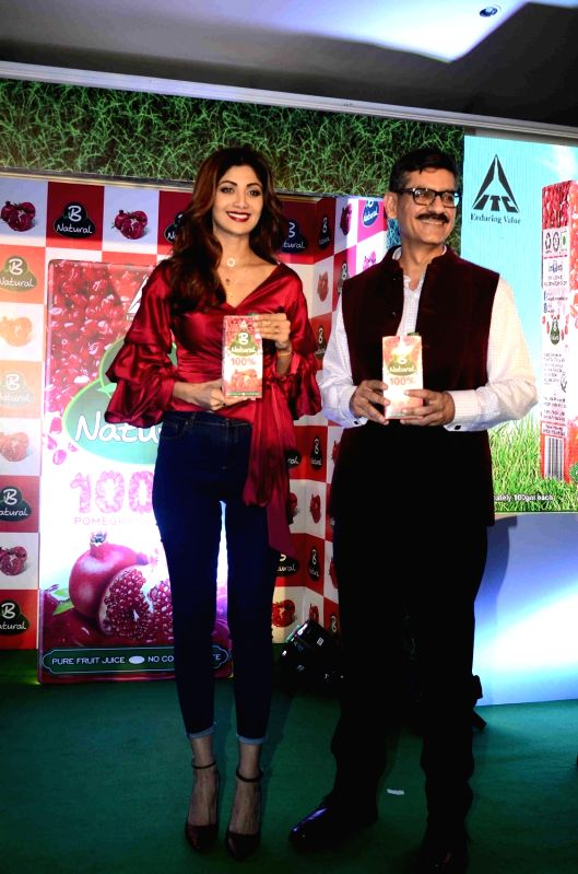 Actress Shilpa Shetty and Hemant Malik, Divisional Chief Executive, ITC Foods Division during the launch of ITC's B Natural juice in Mumbai on April 10, 2017. - Shilpa Shetty and Malik