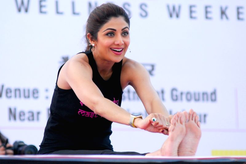 Actress Shilpa Shetty demonstrates a yoga postures during a yoga camp in Jaipur on April 23, 2017. - Shilpa Shetty