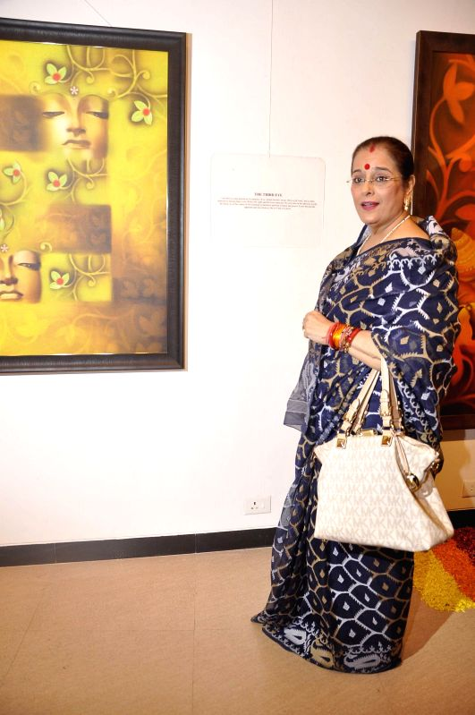 Actress Sonakshi Sinha's during the inauguration of art exhibition Divinity by artist Dr Archana Srivastava in Mumbai on Dec 1, 2014. - Sonakshi Sinha