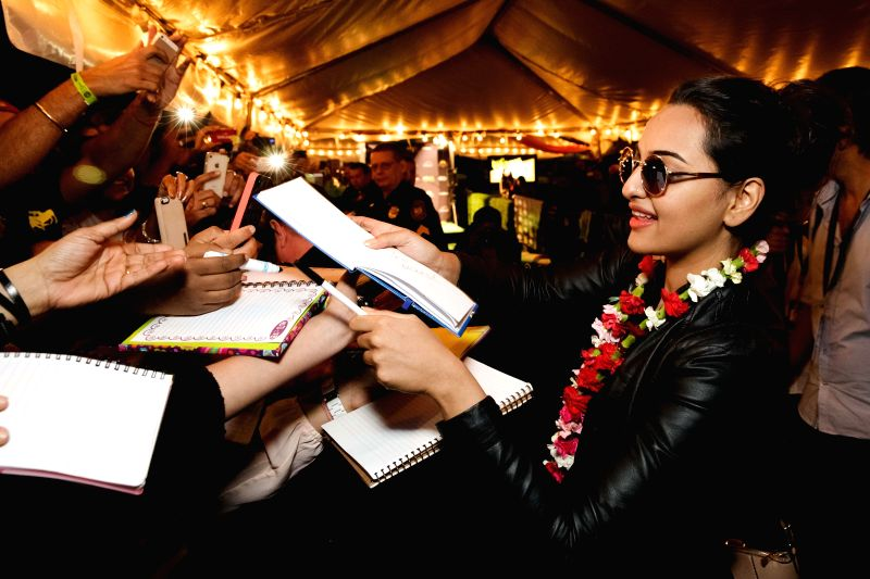 Actress Sonakshi Sinha signs autographs during the15th Annual IIFA weekend held at Curtis Hixon Park in the Tampa downtown area of Florida, United States of America. - Sonakshi Sinha