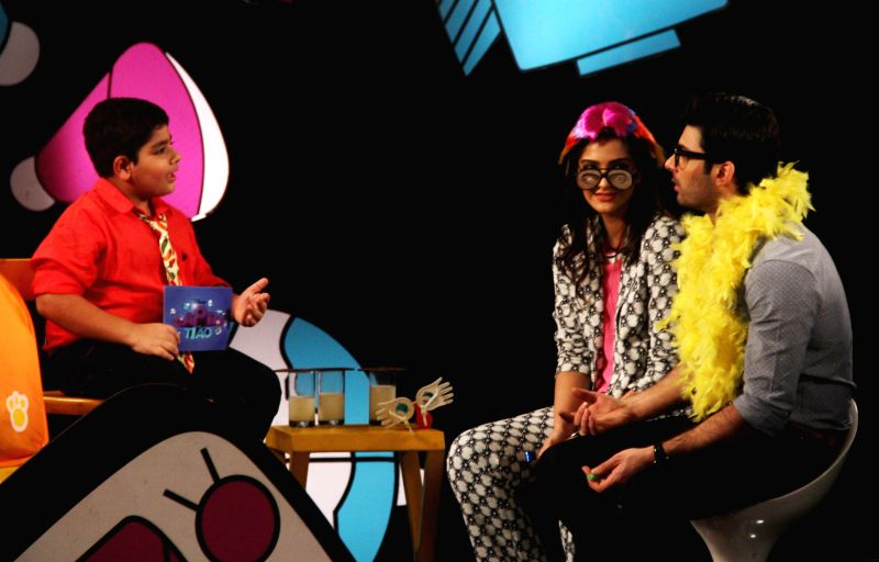 Actress Sonam Kapoor and Pakistani actor Fawad Khan with Sadhil Kapoor on sets of Disney Show Captain Tiao, during the promotion of their upcoming film Khoobsurat in Mumbai, on Aug. 24, 2014. - Sonam Kapoor and Sadhil Kapoor