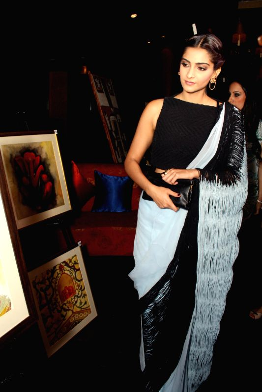 Actress Sonam Kapoor during a painting exhibition in New Delhi on April 22, 2014. - Sonam Kapoor