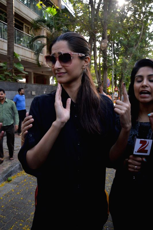 Actress Sonam Kapoor shows her fore finger marked with phosphorous ink after casting his vote at a polling booth during the sixth phase of 2014 Lok Sabha Polls in Mumbai on April 24, 2014. - Sonam Kapoor